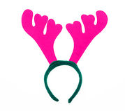Pair of toy reindeer horns. Isolated on a white background. Stock Image