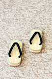 Pair of Traditional Japanese Sandals on Carpet Floor. Royalty Free Stock Photos