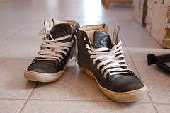 Pair of trainers. Pair of old trainers closeup on the floor royalty free stock image