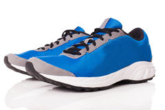A pair of trainers. Picture of a pair of blue trainers over a white background royalty free stock photo