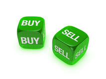 Pair of translucent green dice with buy, sell sign Stock Photo