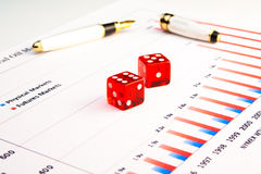A pair of transparent dice on financial chart Stock Photo