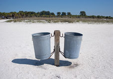 Pair of trash cans on a beach Stock Photo