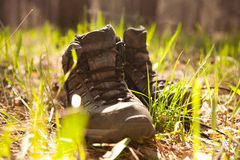 Pair of traveler hiker shoes standing in the grass Royalty Free Stock Image