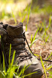 Pair of traveler hiker shoes standing in the grass Royalty Free Stock Images