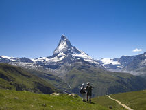 A pair of trekker on the trail of Matterhorn area Royalty Free Stock Image