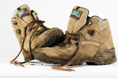 Pair of trekking boots. With mud on them on white background Stock Images