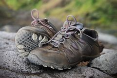 A pair of trekking shoes. A pair of hiking shoes on the rock stock photo