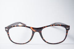 A pair of trendy brown eyeglasses royalty free stock photography