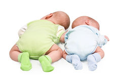 Pair of twins. Lying on a stomach Stock Photo