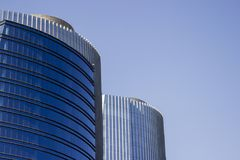 Pair of twins corporate blue office buildings. royalty free stock photo