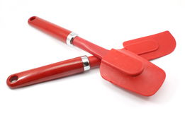 Pair of two red spatulas Stock Photo