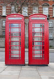 A pair of typical red phone booths in London Stock Images