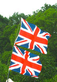 Pair of Union Flags. A pair of Union Flags flying on a festival pole Stock Photos
