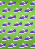 Pair of unisex and kids sport shoes. On green background royalty free stock photography