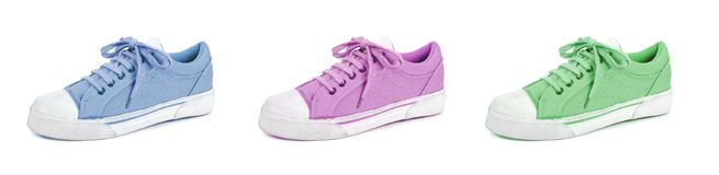 Pair of unisex and kids sport shoes. On white background royalty free stock images