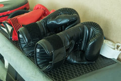 A pair of used black boxing gloves Royalty Free Stock Photography