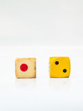 A pair of used dice on white background Royalty Free Stock Image