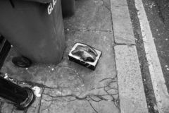 Abandoned shoes, Norwich Street, City of London, UK royalty free stock photography