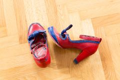 A pair of used shoes of a woman. On the floor royalty free stock image