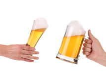 Pair of very cool beer glasses making a toast. Beer splash isolated on white background Stock Photos