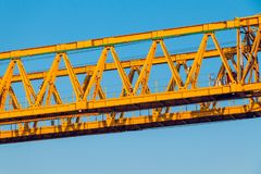 A pair of vibrant yellow construction trusses royalty free stock photography