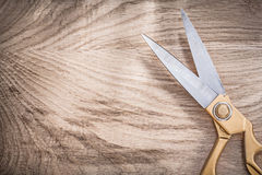 Pair of vintage golden scissors on wooden board copy space Royalty Free Stock Photos