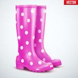 Pair of violet rain boots. Pair of mottled speckled violet rubber rain boots. Symbol of garden wok or autumn and weather. Vector illustration Isolated on white Stock Images