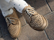 Pair of walking shoes. Detail of a pair of walking shoes on feet Royalty Free Stock Images