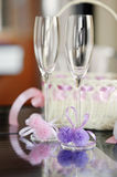 A pair of wedding glasses and a basket. A pair of wedding glasses and white basket royalty free stock images