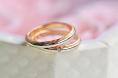 Pair of wedding ring sitting at the edge of box 2 Royalty Free Stock Images