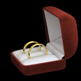 Pair of wedding rings. A pair of wedding rings in jewelry box on black background Royalty Free Stock Photography