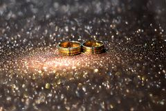 A pair of wedding rings made of 22 carat gold. Yellow as a symbol of marriage stock photo