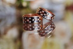Pair of wedding rings on table Royalty Free Stock Image