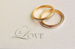 A Pair of Wedding Rings with text 'love' Royalty Free Stock Photos