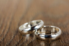 Pair of wedding rings on a wooden background Royalty Free Stock Photos