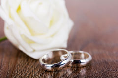 Pair of wedding rings on a wooden background Stock Photography