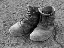 Pair of well worn work boots Royalty Free Stock Image