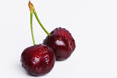 A pair of wet red cherries. royalty free stock photography