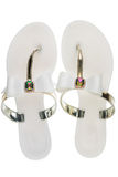 Pair of white beach sandals in rhinestones, isolated on white background. Royalty Free Stock Images