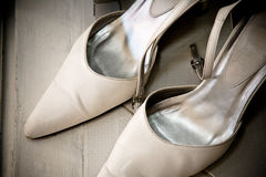 A pair of white bridal wedding shoe Royalty Free Stock Photography