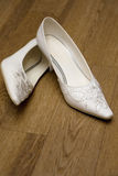 Pair of White Bride's Shoes Stock Photography