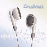 Pair of white  earphones Stock Image