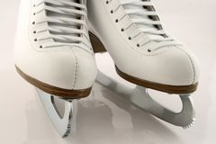 A pair of white figure skates Royalty Free Stock Photos