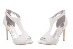 Pair of white high heel woman shoes Stock Photography