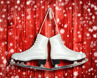 Pair of White Ice Skates on red wooden backround Stock Image