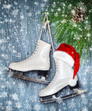 Pair of White Ice Skates and Santa Claus hat - backround Stock Photos