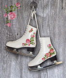 Pair of White Ice Skates with vintage roses decoration - background Royalty Free Stock Photo