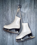 Pair of White Ice Skates on wooden  backround Royalty Free Stock Images