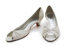 Pair of white lady's shoes Royalty Free Stock Photos